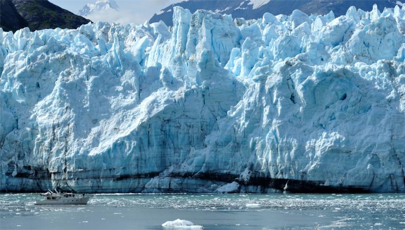 A boat and a glacier in Alaska