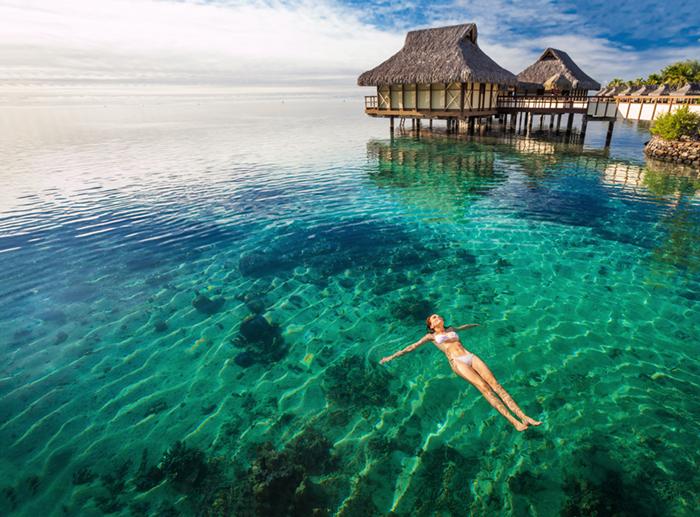 A woman swimming in Tahiti