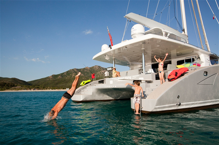 Kids having fun on a catamaran