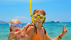 Mother and daughter snorkeling