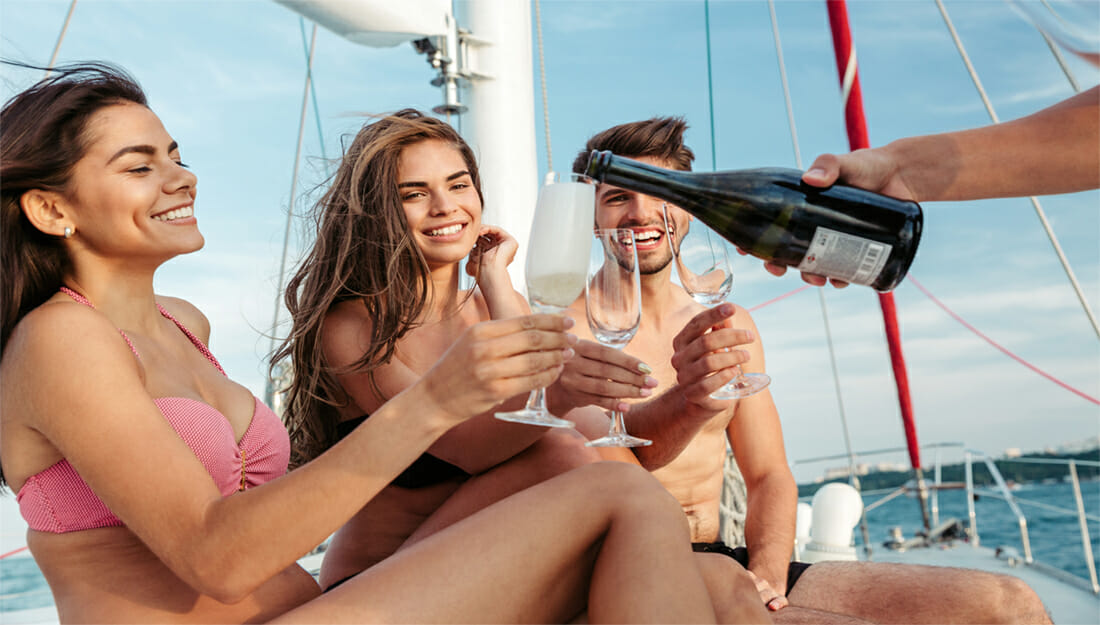 People drinking champagne on a boat