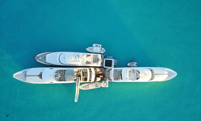 Three yachts in a tandem yacht charter