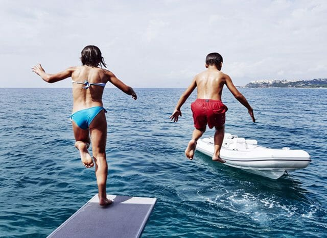 Blue Deer kids jumping into water